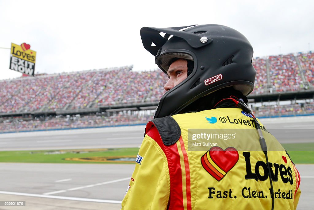 Raphael Diez, tire changer for Chris Buescher, driver of the #34 Love's Travel Stops/CSX-Play it Safe Ford, looks on from the pit box prior to the NASCAR Sprint Cup Series GEICO 500 at Talladega Superspeedway on May 1, 2016 in Talladega, Alabama.