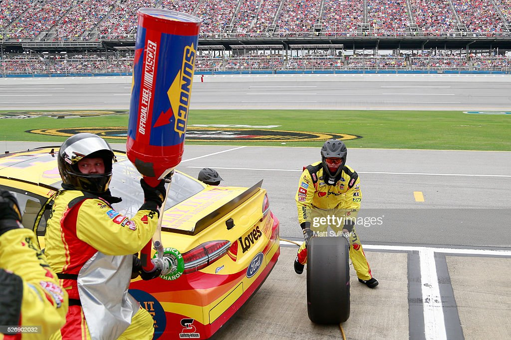 Raphael Diez, tire changer for Chris Buescher, driver of the #34 Love's Travel Stops/CSX-Play it Safe Ford, comes around the car with a tire during the the NASCAR Sprint Cup Series GEICO 500 at Talladega Superspeedway on May 1, 2016 in Talladega, Alabama.