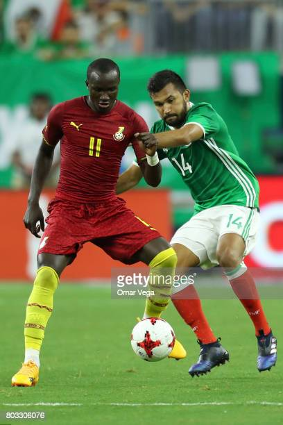 Raphael Dwamena of Ghana fights for the ball with Hedgardo Marin of Mexico during the friendly match between Mexico and Ghana at NRG Stadium on June...