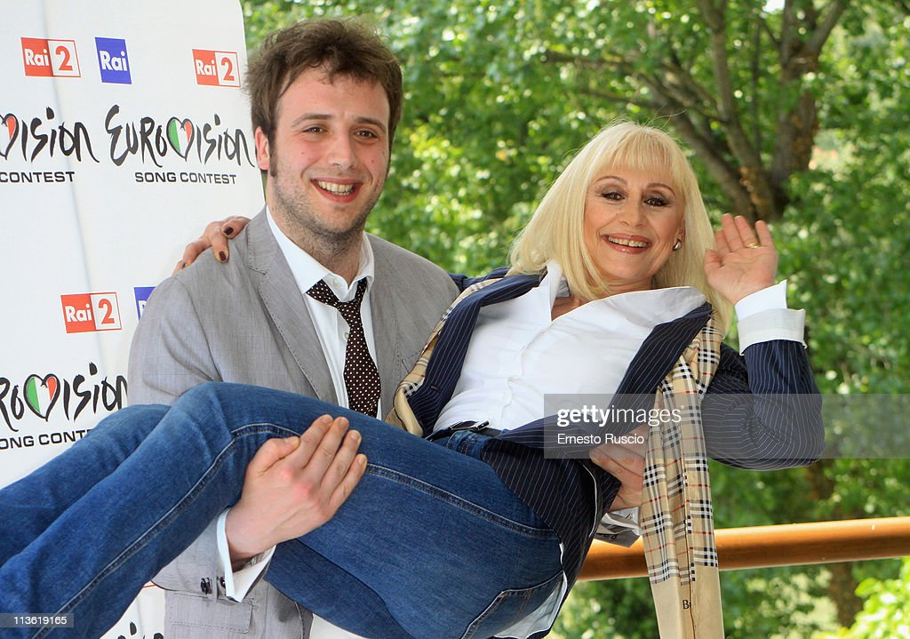 Raphael Gualazzi and <a gi-track='captionPersonalityLinkClicked' href=/galleries/search?phrase=Raffaella+Carra&family=editorial&specificpeople=2838357 ng-click='$event.stopPropagation()'>Raffaella Carra</a> attend the 'Eurovision Song Contest 2011' photocall at Circolo Sportivo RAI on May 4, 2011 in Rome, Italy.