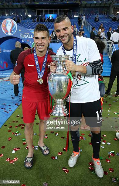 Raphael Guerreiro and goalkeeper of Portugal Anthony Lopes pose with the trophy following the UEFA Euro 2016 final match between Portugal and France...