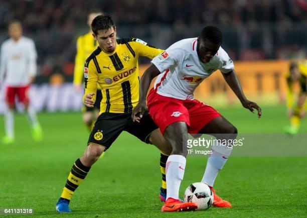 Raphael Guerreiro of Borussia Dortmund and Dayot Upamecano of RB Leipzig battle for the ball during the Bundesliga soccer match between Borussia...
