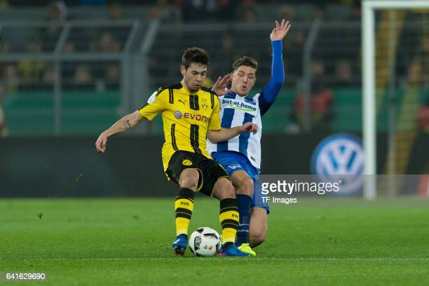 Raphael Guerreiro of Borussia Dortmund and Niklas Stark of Hertha BSC battle for the ball during the DFB Cup Round Of 16 match between Borussia...