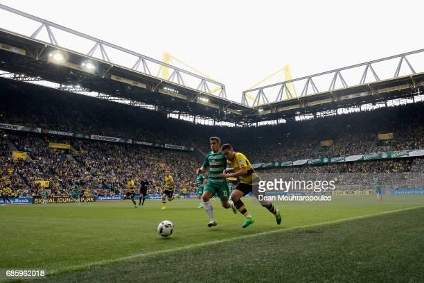 Raphael Guerreiro of Borussia Dortmund battles for the ball with Fin Bartels of Werder Bremen during the Bundesliga match between Borussia Dortmund...