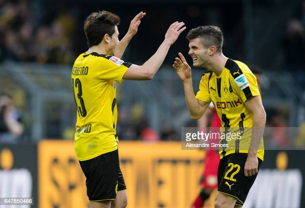 Raphael Guerreiro of Borussia Dortmund celebrates after scoring the goal to the 62 together with Christian Pulisic during the Bundesliga match...
