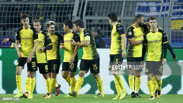 Raphael Guerreiro of Borussia Dortmund celebrates scoring his sides first goal with his Borussia Dortmund team mates during the UEFA Champions League...