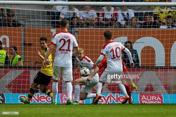 Raphael Guerreiro of Dortmund and Dominik Kohr of Augsburg Martin Hinteregger of Augsburg und Daniel Baier of Augsburg battle for the ball during the...