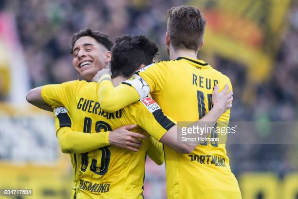 Raphael Guerreiro of Dortmund celebrates his team's first goal with his team mates Emre Mor and Marco Reus during the Bundesliga match between SV...