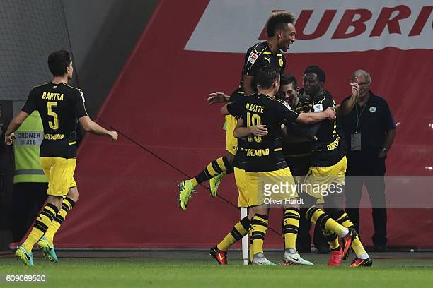 Raphael Guerreiro of Dortmund celebrates scoring the opening goal with his team mates during the Bundesliga match between VfL Wolfsburg and Borussia...
