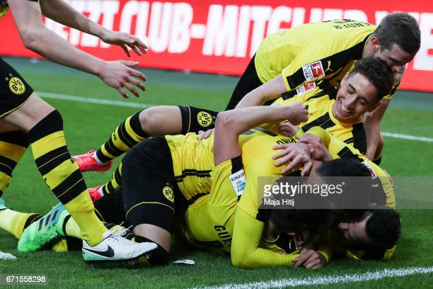 Raphael Guerreiro of Dortmund celebrates with his teammates after scoring his team's third goal during the Bundesliga match between Borussia...