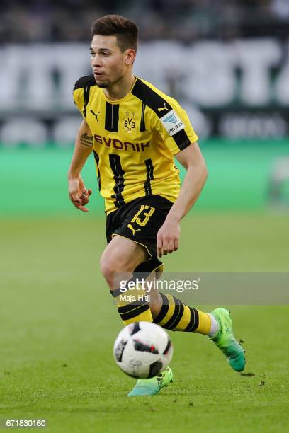 Raphael Guerreiro of Dortmund controls the ball during the Bundesliga match between Borussia Moenchengladbach and Borussia Dortmund at BorussiaPark...