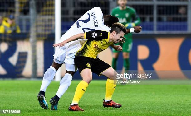 Raphael Guerreiro of Dortmund in action against Serge Aurier of Tottenham Hotspur FC during the UEFA Champions League Group H soccer match between...