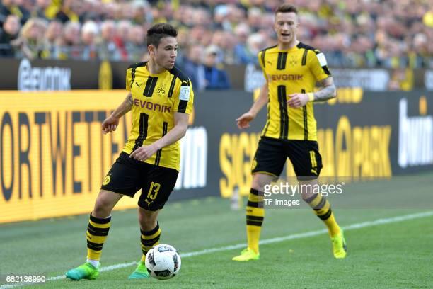Raphael Guerreiro of Dortmund Marco Reus of Dortmund in action during the Bundesliga match between Borussia Dortmund and TSG 1899 Hoffenheim at...