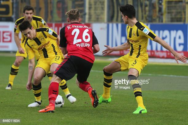 Raphael Guerreiro of Dortmund Maximilian Philipp of Freiburg Marc Bartra of Dortmund battle for the ball during the Bundesliga match between Sport...