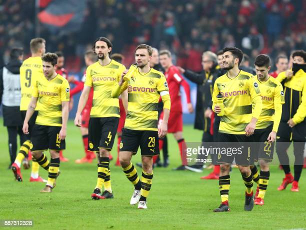 Raphael Guerreiro of Dortmund Neven Subotic of Dortmund Marcel Schmelzer of Dortmund Nuri Sahin of Dortmund and Christian Pulisic of Dortmund look...
