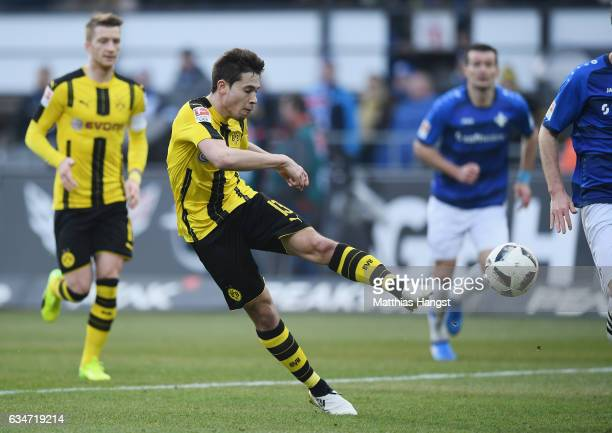 Raphael Guerreiro of Dortmund scores his team's first goal during the Bundesliga match between SV Darmstadt 98 and Borussia Dortmund at Stadion am...
