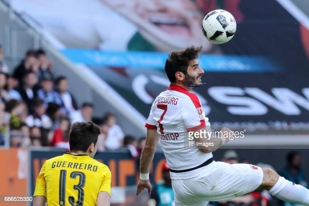 Raphael Guerreiro of Dortmund und Halil Altintop of Augsburg battle for the ball during the Bundesliga match between FC Augsburg and Borussia...