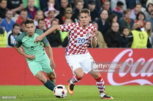 Raphael Guerreiro of Portugal and Marko Pjaca of Croatia during the European Championship match Round of 16 between Croatia and Portugal at Stade...