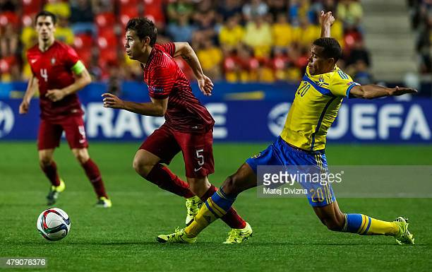 Raphael Guerreiro of Portugal battles for the ball with Robin Quaison of Sweden during UEFA U21 European Championship final match between Portugal...