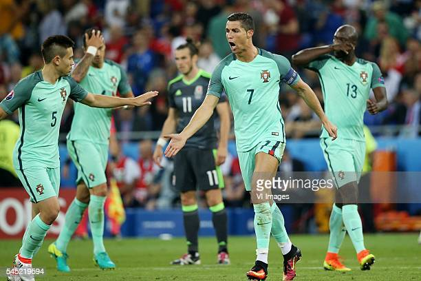 Raphael Guerreiro of Portugal Cristiano Ronaldo of Portugal during the UEFA EURO semifinal match between Portugal and Wales on July 6 2016 at the...