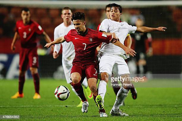 Raphael Guzzo of Portugal competes with Moses Dyer of New Zealand for the ball during the FIFA U20 World Cup New Zealand 2015 Round of 16 match...