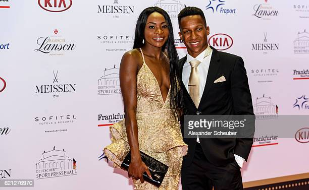 Raphael Holzdeppe and Sosthene Moguenara pose during the German Sports Media Ball at Alte Oper on November 5 2016 in Frankfurt am Main Germany