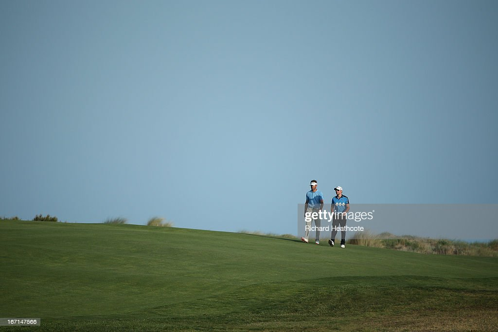 Raphael Jacquelin of France and Maximilian Kieffer of Germany walk down the 18th fairway for the 9th time during the final round of the Open de...