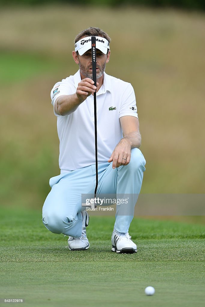 <a gi-track='captionPersonalityLinkClicked' href=/galleries/search?phrase=Raphael+Jacquelin&family=editorial&specificpeople=208683 ng-click='$event.stopPropagation()'>Raphael Jacquelin</a> of France lines up a putt during the rain delayed third round of the BMW International Open at Gut Larchenhof on June 26, 2016 in Cologne, Germany.