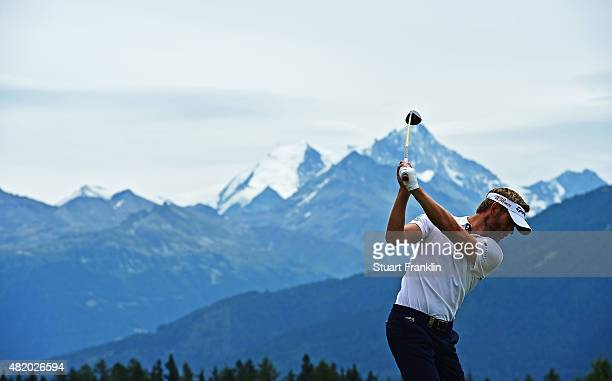 Raphael Jacquelin of France plays a shot during the final round of the Omega European Masters at CranssurSierre Golf Club on July 26 2015 in...