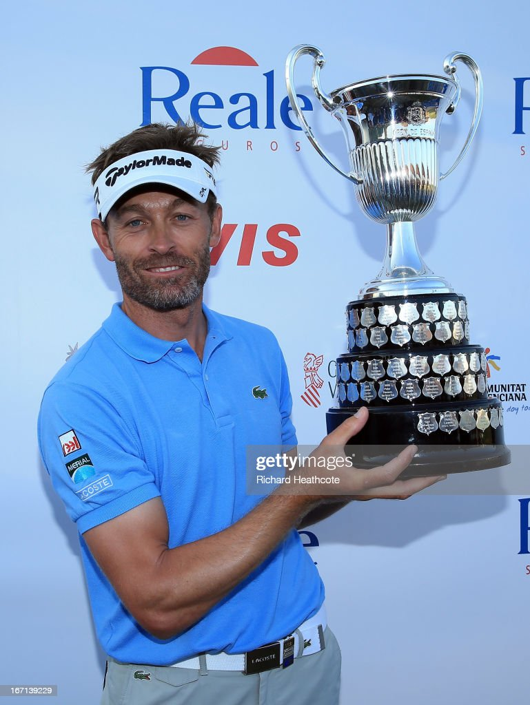 Raphael Jacquelin of France poses with the trophy after winning on the 9th playoff hole during the final round of the Open de Espana at Parador de El...