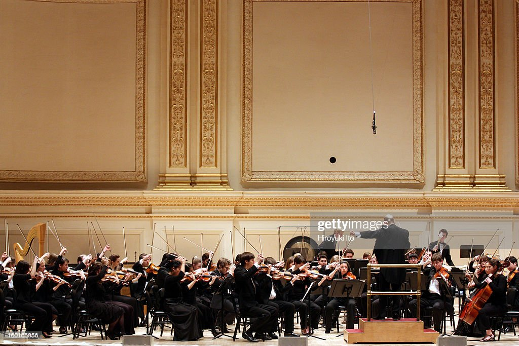Raphael Jimenez leading the Oberlin Orchestra at Carnegie Hall on Saturday night, January 19, 2013.This image:Raphael Jimenez leading the Oberlin Orchestra in Christopher Rouse's 'Iscariot.'