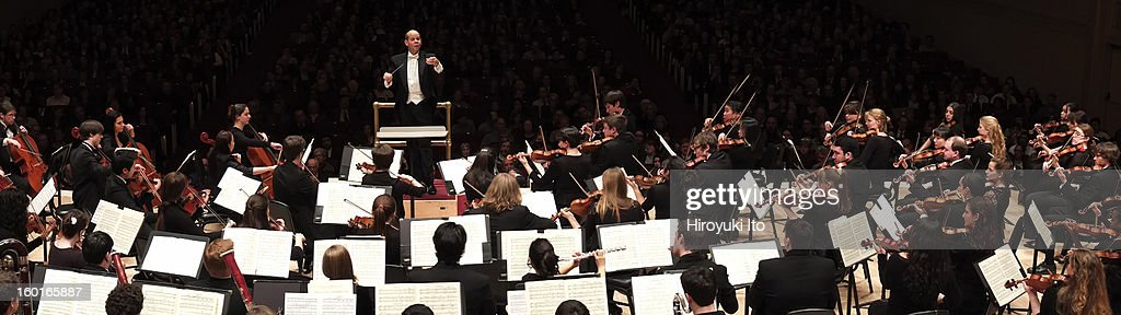 Raphael Jimenez leading the Oberlin Orchestra at Carnegie Hall on Saturday night, January 19, 2013.This image:Raphael Jimenez leading the Oberlin Orchestra in Ravel's 'La valse.'