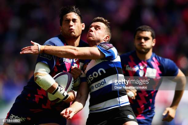 Raphael Lakafia of Stade Francais is tackled by George Ford of Bath Rugby during the European Rugby Challenge Cup match between Stade Francais Paris...