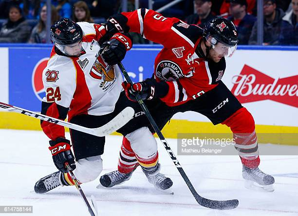 Raphael Maheux of the Quebec Remparts and Eric Leger of the Baie Comeau Drakkar during their QMJHL hockey game at the Centre Videotron on October 14...