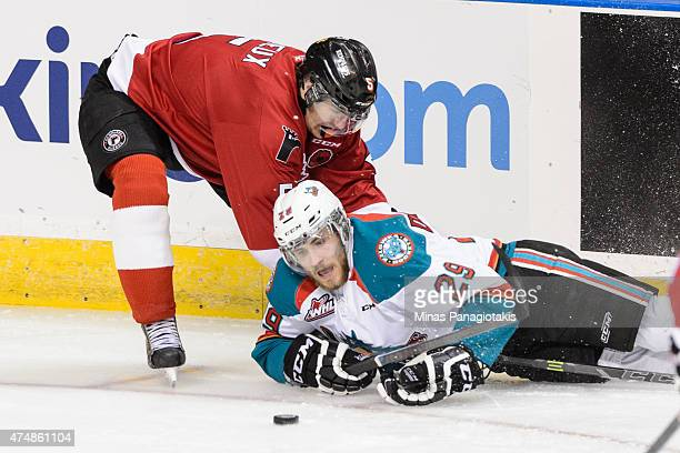 Raphael Maheux of the Quebec Remparts takes down Leon Draisaitl of the Kelowna Rockets in Game One during the 2015 Memorial Cup at the Pepsi Coliseum...