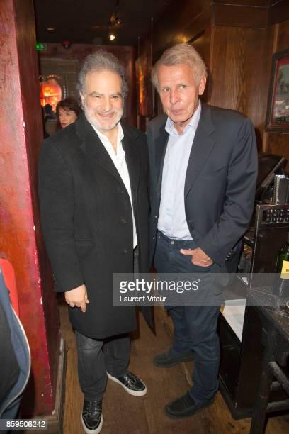 Raphael Mezrahi and Patrick Poivre D'Arvor attend 'Carnets d'un Sale Gosse' Laurent Gerra Signing his book at Buddha Bar on October 9 2017 in Paris...