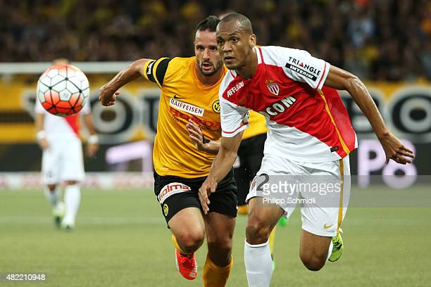 Raphael Nuzzolo of BSC Young Boys fights for the ball with Fabinho of AS Monaco during the UEFA Champions League third qualifying round 1st leg match...