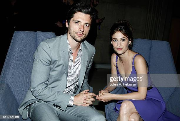 Raphael Personnaz and Melanie Bernier attend the Miu Miu Resort Collection 2015 at Palais d'Iena on July 5 2014 in Paris France