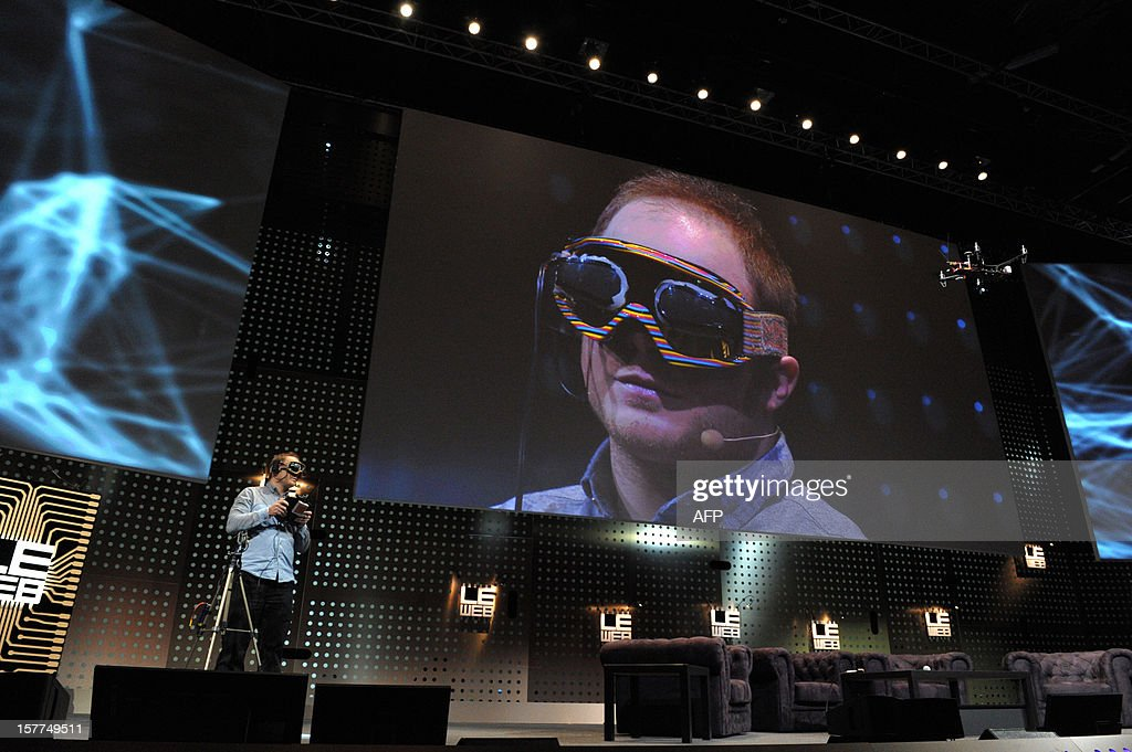 Raphael Pirker from Switzerland, founder of Team BlackSheep uses virtual reality goggles to simulate the sensation of flight in the real world during a demonstration, flying from the perspective of a model aircraft, during a session of LeWeb'12 in Saint-Denis, near Paris on December 6, 2012.