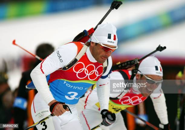 Raphael Poiree of France makes a change over with team mate Ferreol Cannard in the Mens Biathlon 4x75km Relay Final on Day 11 of the 2006 Turin...