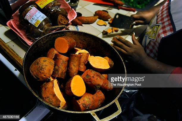 Raphael Richmond cuts up some yams she got at a local church food bank She made sweet potato pies and cooked yams with them Raphael Richmond and her...
