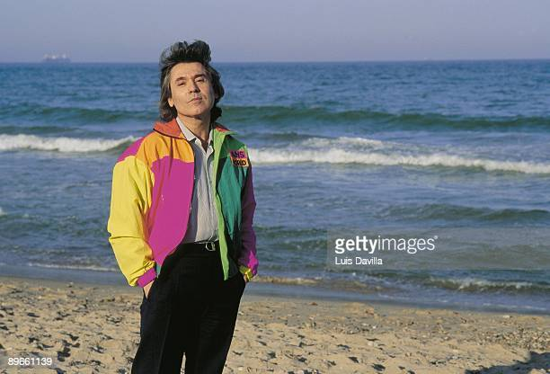 Raphael singer The singer in a beach with the sea behind