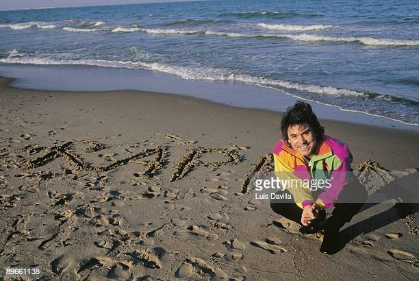 Raphael singer The singer in the seashore with his name written in the beach