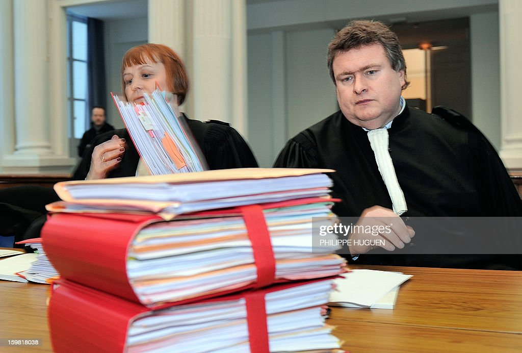 Raphael Thery (R), lawyer of François Taton, the father of slain 4-year old Typhaine, sits next to Amelie Leroy (L), lawyer of Marie-Jose Taton, the child's paternal grandmother, on January 21, 2013 at the Douai courthouse in northern France, before the trial of the mother and stepfather of the child, Anne-Sophie Faucheur and Nicolas Willot, in connection with her death. The body of Typhaine was found in December 9, 2009 in a suburb of the southern Belgian city of Charleroi, and Faucheur and Willot finally recognized that she had died at their house on June 10, 2009 and that her body had been burried somewhere in Belgium.