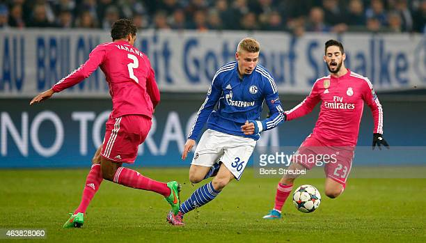 Raphael Varane and Isco of Real Madrid challenges Felix Platte of Schalke during the UEFA Champions League Round of 16 match between FC Schalke 04...