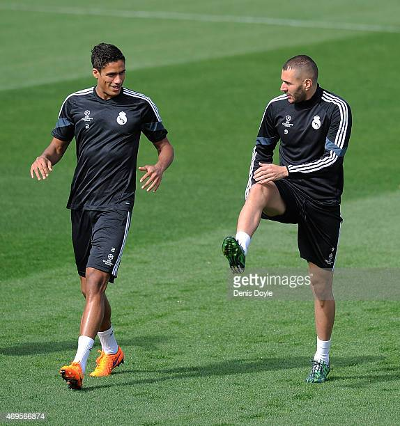 Raphael Varane and Karim Benzema of Real Madrid warm up during the Real Madrid CF training at Valdebebas grounds ahead of the UEFA Champions League...