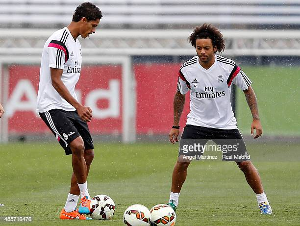 Raphael Varane and Marcelo Vieira of Real Madrid in action during a training session at Valdebebas training ground on September 19 2014 in Madrid...
