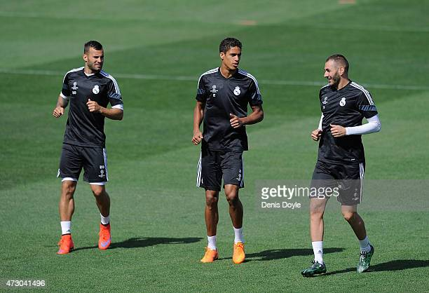 Raphael Varane Karim Benzema and Jesse Rodriguez of Real Madrid warm up during the Real Madrid CF training session ahead of the UEFA Champions League...