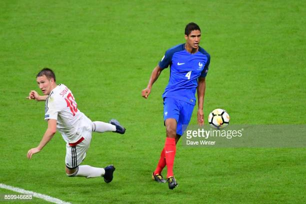 Raphael Varane of France and Anton Saroka of Belarus during the Fifa 2018 World Cup qualifying match between France and Belarus on October 10 2017 in...