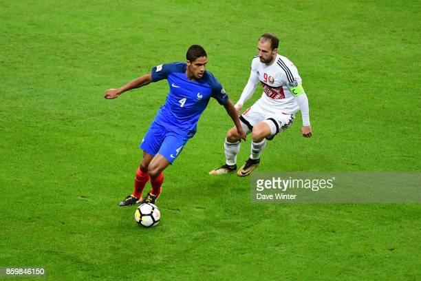 Raphael Varane of France and Igor Stasevich of Belarus during the Fifa 2018 World Cup qualifying match between France and Belarus on October 10 2017...